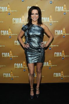 Martina McBride Cocktail Dress - Martina went very metallic for the CMAs in this daring number. The gathering design makes for an interesting red carpet wear.