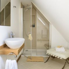 Tiny bathroom Sloped Ceiling - Bathroom suites that make the most of awkward spaces. Sloped Ceiling Bathroom, Small Attic Bathroom, Loft Bathroom, Upstairs Bathrooms, Slanted Ceiling, Attic Shower, Small Bathrooms, Shower Rooms, Neutral Bathroom