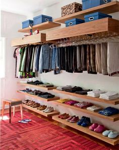 Place floating shelves above and below your clothing rack to optimize storage space without sacrificing the open display.
