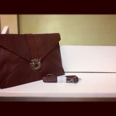 Fashionable brown clutch. Available at Christinamariesonline.com - $18.99