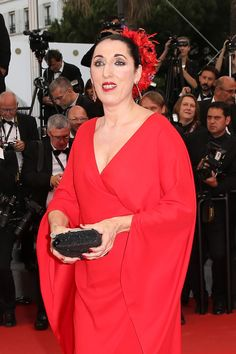 chopardredcarpet:  Member of the Jury, Spanish actress Rossy de Palma wore a pair of earrings from Chopard's Temptations Collection featuring rubies, blue sapphires, pink sapphires, orange sapphires and tsavorites set in 18-karat rose gold.