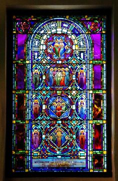 The Ministry of Music stained glass window, by Tiffany, is one of five windows, at the Theodore Parker Church that have been recently restored.