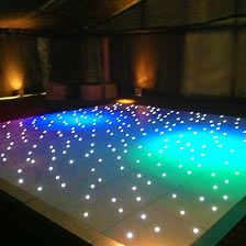 White Starlit Dance Floor Illuminated By A Purple Colour Wash