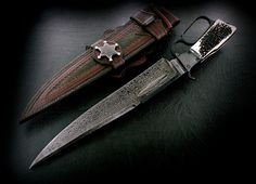 CAS Claudio Sobral Winchester-inspired Bowie knife. Dammascus steel, fullered blade with sparring bar and a stag handle.