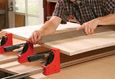Make your woodworking clamps longer with this simple jig and save a bundle of money in the process