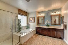 bathroom with 4-light wall sconce