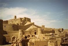 Located in the Kerman Province of Iran, the ancient fortified city of Bam (or Arg-e-Bam) dates back to the Parthian Empire, some 2000 years ago. Moulded out of the red clay of the Dasht-e Kavir desert, the city was permanently abandoned in Parthian Empire, Photo Journal, Historical Architecture, Ghost Towns, Pilgrimage, World Heritage Sites, Abandoned Places, Vacation Spots, Iran