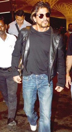 Shah Rukh Khan looked dapper in denim jeans and leather jacket. #Bollywood #Fashion #Style