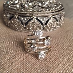 Lia Sophia Silver Ring with Crystals This ring is simple yet makes a statement when worn. Very cute!! Only worn once! Reasonable offers are welcome Lia Sophia Jewelry Rings