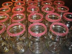 Mason jars dipped in corn syrup w/ red, yellow & blue crystal sprinkles (dry over night)