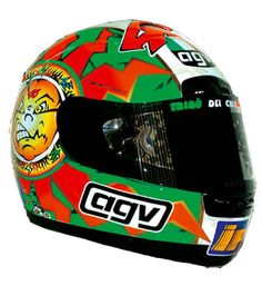 1998 - Valentino Rossi raced at Imola in the 250cc class with a Tricolore helmet design with a green, white and red colour scheme. The Drudi designed helmet was a simple but effective design that was a variation of Rossi's main Sun and Moon helmet design, except it was decked out in Italian colours. Rossi had also dyed his hair red, white and green for the occasion.