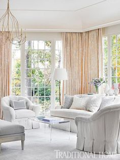 Between the dressmaker details on the tufted chairs and the embroidered tapestry fabric, the master bedroom sitting area certainly has romantic appeal. - Traditional Home ®/ Photo: Emily Jenkins Followill / Design: Phoebe Howard