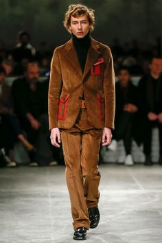 """Prada Fall 2017 Menswear Fashion Show featured many 1970s inspired trends and design elements. """"Mrs. Prada conceded the '70s had ended up a heavy flavor here, but she insisted it was inadvertently done, even if it was a period she was attached to for its history of uprising and protest,"""" said Vogue. This Corduroy suit can give clear flashbacks to 1973 Bloomingdale's mens corduroy suits. Jenisha Gerard 4/13/17."""