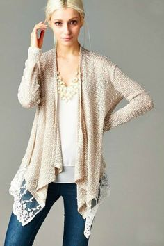 This is pretty knit tunic is perfect for layering with all of your favorite tanks. Taupe knit cardigan with lace trim. Fits true to size with an easy fit. ALL SALES ON SALE ITEMS ARE FINAL.
