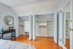 closets in a room with slanted ceilings