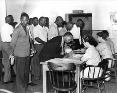 1948 | Black Americans register to vote as South Carolina Democrats in Charleston on July 17, 1948.  Blacks in South Carolina registered throughout the state after a federal court order was issued forcing the South Carolina Democratic Party to enroll blacks and grant them full participation in party affairs.  In 1944, the U.S. Supreme Court ruled that blacks cannot be denied the right to vote in primary elections.  (AP Photo)