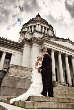 A bride and groom on the steps of a historic building | Van Wyhe Photography