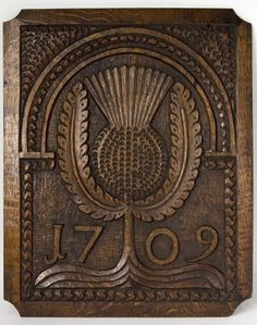 This plaque was part of the oak panelling inside Kilmarnock House and was removed when the house was demolished.