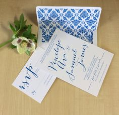 Blue type invite with a flourish lined envelope
