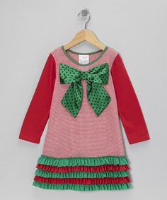 Any happy little elf will look pretty as a present in this festive frock. The addition of girl-friendly pink puts a modern spin on the classic holiday color scheme, while ruffles and a big polka dot bow ensures she'll shine as she rocks around the Christmas tree.