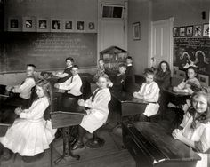 "Kids in school in 1910. Note Benjamin Franklin's ""Join, or Die"" on the blackboard behind the children.  The private college prep ""Potomac School"" in Washington D.C. prior to their 1951 move just across the border to McLean, Virginia."