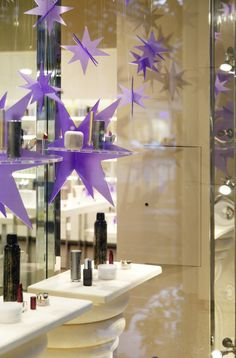 Space NK beauty evolution visual merchandising props and window display.