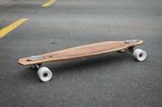 Drop-through recycled wine-barrel longboards by The Paper Rain Project