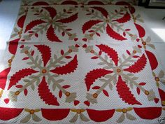 ebay - - red, white, cheddar & olive coxcomb applique quilt, from  Connecticut - the olive was probably originally a deep green that has faded.