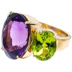 Amethyst And Peridot Yellow Gold Ring. Substantial heavy solid 18k yellow gold ring with bright well polished genuine Amethyst and Peridot. We cannot quite read the markers mark. circa 1990