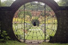 Nightshade's Garden:  In #Nightshade's #Garden ~ The spider's web gate, created in 1936 by Eric Stevenson at Hoveton Hall Gardens (UK).