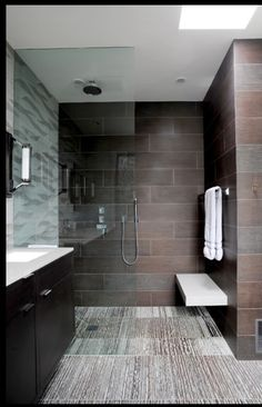 tile colors, shower bench, glass wall between vanity and shower