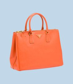 COLOR  PAPAYA  CODE BN1786_NZV_F0S73    TOTE    CLASSIC SHAPES AND TIMELESS ELEGANCE FOR THE GALLERIA CAPSULE COLLECTION, NAMED AFTER THE BRAND'S FIRST, HISTORIC STORE  SAFFIANO CALF LEATHER TOTE  DOUBLE HANDLE  GOLD-PLATED HARDWARE  SAFFIANO CALF LEATHER TRIANGLE LOGO WITH METAL LETTERING  -SIDE SNAP CLOSURE  TWO OUTSIDE POCKETS WITH ZIPPER CLOSURE  FOUR INSIDE POCKETS, ONE WITH ZIPPER CLOSURE  PRADA LOGO LINING  L 35.5 H 26 W 15 CM
