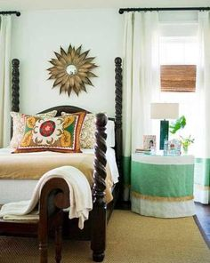 nice bedroom with dark woods, bright walls, earth tone accents