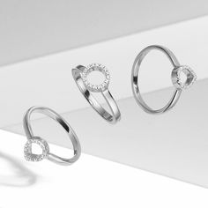 Shine on in silver: Diva diamond rings give a geometric edge to your ring stack.