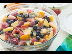 This Creamy Fruit Salad Recipe is made with a Homemade Vanilla Dressing -- no pudding mix here! No bake summer dessert. Includes step by step recipe VIDEO.