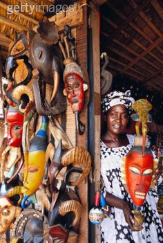 Africa | Woman holding a mask.  Ivory Coast. | ©Connie Coleman