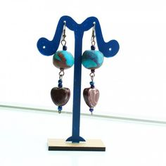 Blue and Bordo Earrings -Handmade earrings from ''Unique handcrafted Jewelry by Arijeta''. These earrings have a blue and bordo round made of fimo on the top, and a bordo heart stone below. They also have blue and bordo gemstones.  Material: They are made of Copper, Ceramic and Fimo Effect (name for a brand of Polymer Clay).