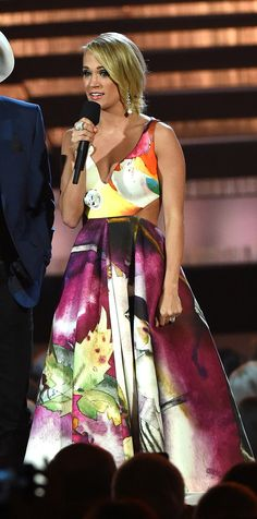 Carrie Underwood wore Gauri & Nainika once more during the CMA Awards choosing a graffiti print dress with a rosette and cut-out detail at the waist