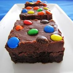 """According to my friend Lauren, """"Want your loved ones to describe your brownies as """"crack brownies""""? Use this frosting recipe and prepare to catch yourself huddled over the pan like a chocolate junkie. Hurts so good."""" Brownie Frosting Recipe"""