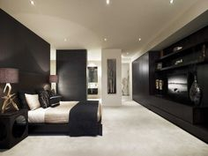 Modern bedroom design idea with wood panelling & built-in shelving using beige colours