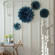 Beautiful greeter + gorgeous wall art (!) at base of stairs to keep positive energy inside YOUR home.