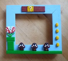 Super Mario Goomba and Plant Picture Photo Frame. $17.50, via Etsy.