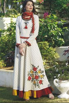 Beautiful cotton check print kurti with colourful pleated boarder and superb embroidery /detailing.