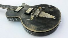 """Scala Guitars Underdog Concert in Faded Black with the """"UNTAMED"""" theme. It is a part of our limited """"DIAMONDS & RUST"""" art collection series."""