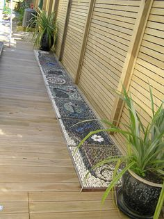 Garden path - pebble mosaics inset in to deck.  Great to walk on in bare feet!