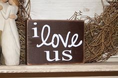 """I love us"" wood sign"