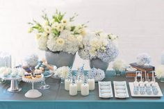 Gorgeous pale blue dessert table with fresh blooms and vintage elements