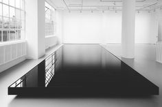 """Noriyuki Haraguchi   """"Oil Pool""""   A low metal container that took up most of the gallery was filled with waste oil, making an opaque and gorgeously reflective surface also notable for its odor.  http://www.artinamericamagazine.com/reviews/noriyuki-haraguchi/"""