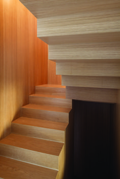 Renovated Art Deco apartment in Rome by SCAPE includes elm wood stairwell