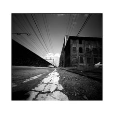 """photo feels like it """"goes on forever"""". the road lines draw your eyes to the horizon. Photography Day, Photoshop Photography, Creative Photography, Street Photography, Pinhole Camera Photos, Low Angle Shot, Wide Angle, Vanishing Point, Experimental Photography"""